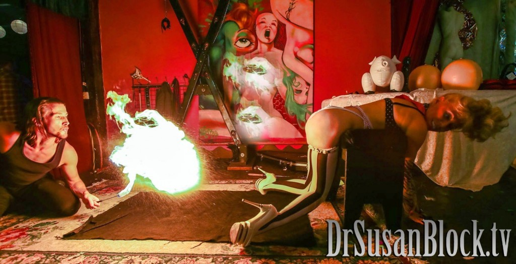 Dark Phoenix gives Dr. Suzy a bday fire spanking.  Photo: JuxLii